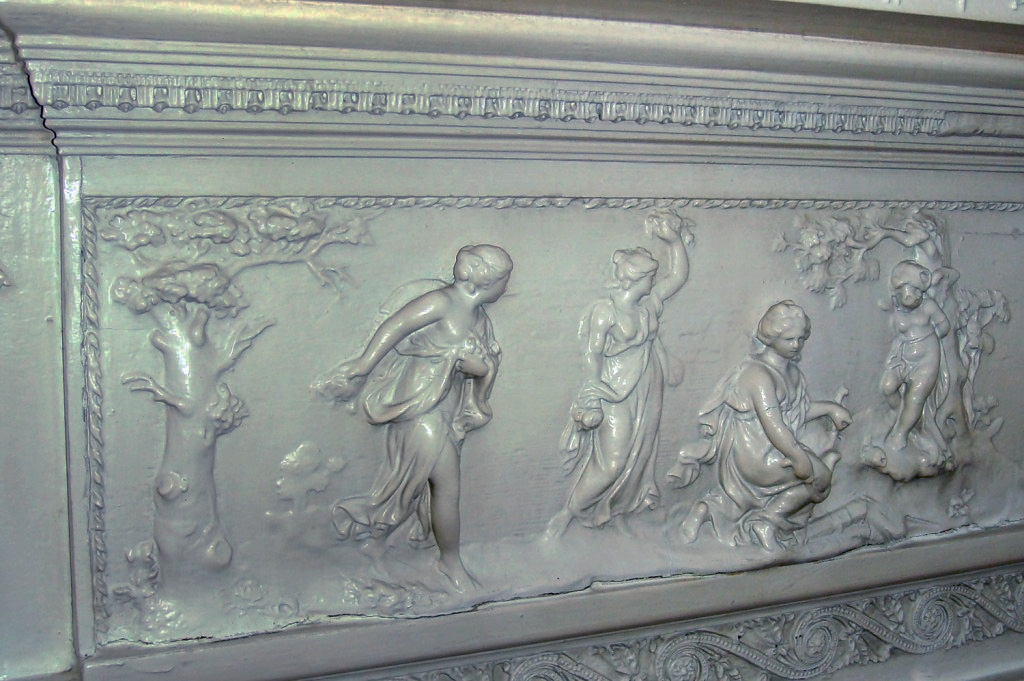 Beautifully carved mantel piece in the Rhett House's Parlor. Although the house is Greek Revival in style, elements from the earlier Adam, or Federal style such as this are visible throughout the house. In the 18th & 19th centuries, architects and designers would publish books of decorative elements and designs, which were then copied by architects and artisans. Britain's Robert Adam (1728 – 1792) was among the most influential of these designers, profoundly influencing Western architecture of the period by re-introducing classical Greek and Roman motifs and elements to the architectural vocabulary of the period.